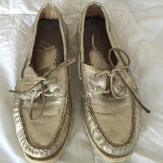 Sperry Top Sider Boat Shoes Lightly worn sperry boat shoes. Metallic coloring adds a stylish touch to these classic shoes. Slight wear on the insides and on the laces but in good condition. Sperry Top-Sider Shoes