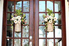 Burlap and Flowers on the front door. Burlap grow bags from Hobby Lobby make cute containers for your front door decor. Using pinks, greens and coral just say spring or summer for the front door!