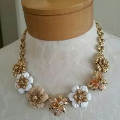 Beautiful enamel necklace Statement necklace in gold tone with enamel flowers in peachy pink, white and tan accented with rhinestones.  Maximum length is just over 18 inches.  Worn once over a collared shirt. Ann Taylor Jewelry Necklaces