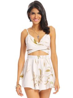 Description:     Sleeve Length  :Sleeveless   Color:White   Pattern:Floral   Style:Sexy   Length:Short   Material:Polyester      Package included:  1*Jumpsuits