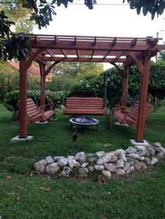 Great outdoor area with pergola, swings and fire pit.
