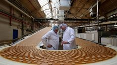 With Madrhiggs... also you can create or manage your industrial plant with the economic help of the people... The production line at the McVitie's factory in Stockport.
