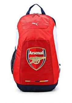 Вместительный рюкзак Puma выполнен из плотного полиэстера красного цвета и оформлен логотипом Arsenal. Детали: одно внутреннее отделение застегивается на двухходовую молнию, внешний карман на молнии, боковой сетчатый карман, широкие лямки регулируются. http://j.mp/1nlF97i