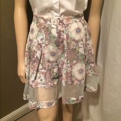 Floral Print Sheer Paneled Skirt This is an awesome skater style skirt in a lovely floral print. The print itself is more neutral which makes this skirt exceptionally versatile. It features a sheer panel of fabric around the bottom of the skirt and a fun zipper in mint in the back. Looks fabulous with a plain tee or sweater! BCNU Skirts Circle & Skater