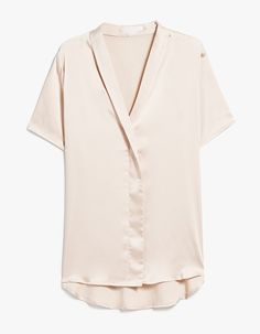 Minimalist blouse from Farrow in Champagne. Slips on. Shawl lapel. Short sleeves. Faux placket. Stepped, rounded hem. Relaxed fit.  • Poly sateen • 97% polyester, 3% spandex • Hand wash cold, hang dry