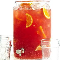 Fall Easy Tailgating Punch Citrus and berry concentrates make this pleasingly refreshing. Ginger ale turns the fruity blend into a bubbly sensation, especially when the ale is well chilled and added just before serving. Alcoholic Punch Recipes, Easy Punch Recipes, Alcoholic Drinks, Drinks Alcohol, Party Drinks, Fun Drinks, Beverages, Mixed Drinks, Easy Mocktail Recipes