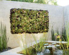 A vertical wall garden!!  Living art. Very awesome!  Details here:  http://www.elledecor.com/home-remodeling/articles/vertical-garden