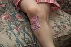Writing Prompt. Where did she get the bandaids? Vaccinations? Did she scrape her knee? Is she human?