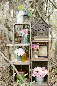 Wooden crates and bird cage, simply & attractive. Great for a weekend show: easy to take apart & put back together!
