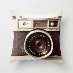 Camera Throw Pillow $35 from Society 6 - 20x20 doesn't include insert - but you can get those at a craft store