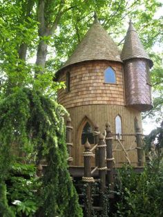 "2-story castle treehouse in London. The whole website is fascinating-- ""hobbit holes,"" treehouses, etc etc."