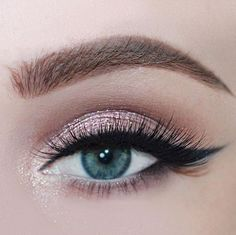 soft shimmery eye with winged liner.