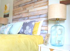 LOVE this headboard made of old pallet wood..