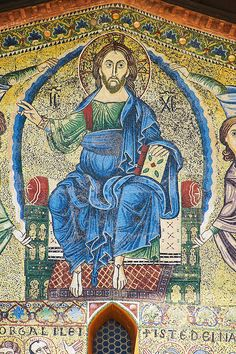 Close up of the 13th century Byzantine Mosaic panel depicting Christ Pantocrator on the Basilica of San Frediano, a Romanesque church, Lucca, Tunscany, Italy. Download as royalty free photos of buy photo wall art prints on line. Photographer Paul Williams.