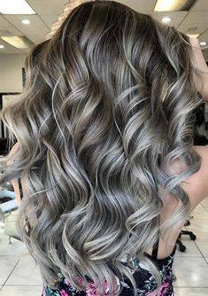 46 Awesome Silver Grey Long Curls to Show Off in 2018. Learn by visiting here how to get the best shades of silver grey hair colors for obsessions in 2018. We have compiled here the most beautiful ideas of silver grey hair colors worn by the top celebrities around the world. Copy this hair color style for amazing looks haircuts in 2018.