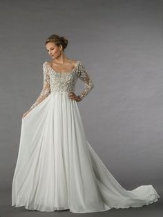 Alita Grahams traditional bridal collection features unique details such as original embroidery pleated silk tulle Swarovski crystals and ribbon-embroidered lace worthy of the Kleinfeld label. The