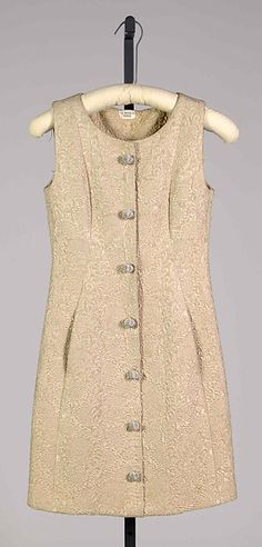 Dinner dress  Design House:House of Balenciaga (French, founded 1937) Designer:Cristobal Balenciaga (Spanish, Guetaria, San Sebastian 1895–1972 Javea) Date:fall/winter 1963–64 Culture:French Medium:Silk Knee-length;   The Met