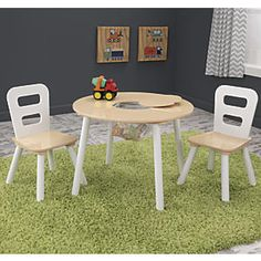 KidKraft Round Table & Chair Set: This sturdy kids' play table and chair set is sized just right for preschoolers. Best of all: remove the hidden cutout in the table's center, and kids can quickly push their toys into the storage net below. Talk about easy toy pickup! This charming KidKraft® furniture set is made of wood and MDF, in white and natural wood tones for a classic look that appeals to both boys and girls...