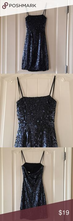 """B. Darlin Black Strapless Sequin Dress B. Darlin black sequin strapless dress Size 1/2. Zipper in the back. Fully lined. Sequins look black or dar gray blue depending on the lighting. 100% polyester. It was only worn once for an event. The bust is about 27"""", waist is about 21"""", length is about 26.5"""". Kept in a smoke free home. B Darlin Dresses Strapless"""