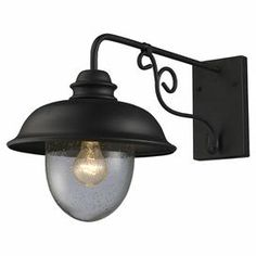 """Outdoor wall sconce with a seeded glass shade and lantern-inspired design.   Product: Wall sconceConstruction Material: Metal and glassColor: Matte black and brownFeatures: Seeded glass shadeSuitable for outdoor useAccommodates: (1) 100 Watt  medium base bulb - not includedDimensions: 14"""" H x 10.5"""" W x 22"""" D"""