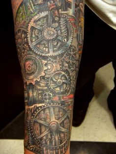 Mechanical tattoo sleeve - 25 Awesome Steampunk tattoo designs  <3 !