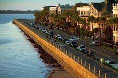 Charleston, South Carolina Elegant, sunbathed antebellum mansions lining the mile-long Battery promenade overlook the historic harbor where ...