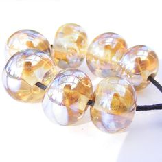 Handmade lampwork bead set of streaky yellow beads - metallic, highly reflective lemon glass beads
