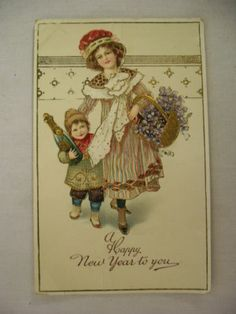 VINTAGE EMBOSSED NEW YEAR POSTCARD LADY & CHILD W/CHAMPAGNE BOTTLE UNMAILED