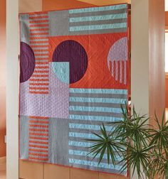 Mix curved and stripped piecing to create a graphic modern quilt.