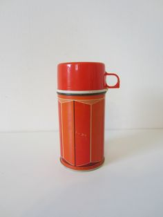 thermos, red geometric, vintage camping gear, metal travel mug, 1970s. $14.00, via Etsy.