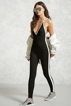 A stretch-knit jumpsuit featuring stripes down the sides, a V-neckline with self-tie halter straps, contrast piping, and a form-fitting silhouette.