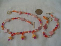 Multi-faceted glass & china vintage neclace & bracelet set. unusual colors combinations. Stunning pieces!