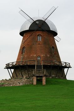 love the stone windmill...... love its short & stocky architecture as well....
