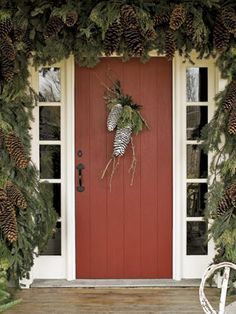 32 Easy Pine Cone Crafts to Spruce up Your Home This Holiday Season Christmas Pine Cone door swag with flocked sugar pine cones and lichen-covered twigs accented with incense cedar and other holiday greens on Country Living Pine Cone Decorations, Christmas Door Decorations, Christmas Porch, Farmhouse Christmas Decor, Country Christmas, Holiday Wreaths, Winter Christmas, Christmas Garlands, Christmas Design