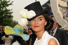 Topping! This lady looked stunning in a rose decked top hat paired with a chic bun and a lovely cream silk shirt at Ascot
