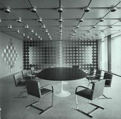 Mural by Victor Vasarely - Brno Chairs by Mies - Tulip Table by Saarinen