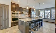 Gleaming stainless steel accents define this sleek, contemporary kitchen. New townhomes built by K. Hovnanian Homes in the Parkside community. Washington, D.C.