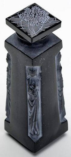 """1907 - 1917  A Lalique glass Ambre for D""""Orsay perfume bottle in black glass with white patina, 1912. Raised LALIQUE AMBRE D""""ORSAY."""