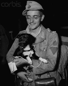 "German POW with Pet Puppy - US001215 - Rights Managed - Stock Photo - Corbis. 21-year old prisoner of war Wolf Dietrick Setzerfand, from Ehrfurt, Germany, brought a black fox terrier, ""Ko"", with him to detention camp in Virginia. He found the dog in Libya during the Africa campaign. Captured in Tunisia, he was a one-year army veteran who wore the ribbon of the 2nd class Iron Cross."