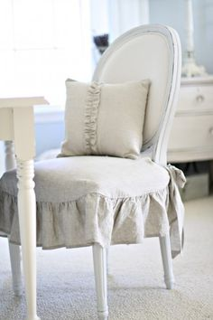 White painted chair with skirted seat.  Lovely seating!