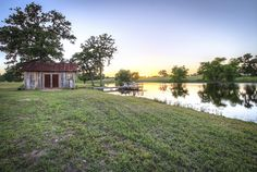 Talk about a picture perfect country getaway: This custom built 336-square-foot cabin sits on 24 sprawling acres in West Point, Texas — just steps from its own four-acre constant flow lake, tiny lakehouse, and wooden pier. The rustic wood-paneled interior features a living space, full kitchen, bathroom, and two lofted bedrooms, all housed under a corrugated metal roof.