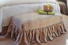 Bench covered with a burlap slipcover ...