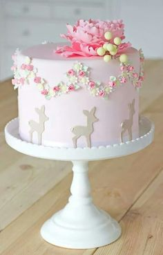 Would be a perfect baby girl shower cake for a Woodland theme!