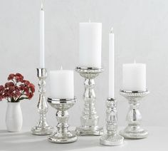 Our shimmery Antique Mercury Glass Candle Holders bring a festive look to candlelight. Crafted of blown glass and metal, they have an antiqued finish and each is slightly different. Place them as a centerpiece on a table or as a focal point on a m… Mercury Glass Candle Holders, Wooden Candle Holders, Hurricane Candle, Pottery Barn, Taper Candles, Candleholders, Christmas Traditions, A Table, Picnic Table