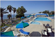 Pool Area during the day facing the sea at Poseidonia Beach Hotel in Limassol Cyprus
