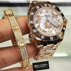 Beautiful stack. Rolex & Cartier.