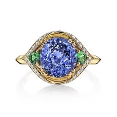 This delightful violet fancy sapphire and tsavorite garnet ring was designed in collaboration with Omi privé. Colors that warm the soul...#omiprive #jewellery #jewelryaddict #jewelryartist #remyrotenier #jewelry #tsavorite #fancysapphire