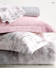 Cozy flannel forest fox and pin dot bedding pairs with faux fur. Perfect for warding off winter's chill.