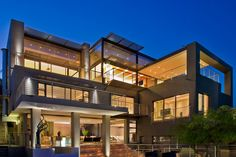 House Tat was designed by Nico van der Meulen Architects, and it is located in Bassonia, an urbanization near Johannesburg, South Africa. The home has spectacular views over its surroundings, and a stunning interior to match.