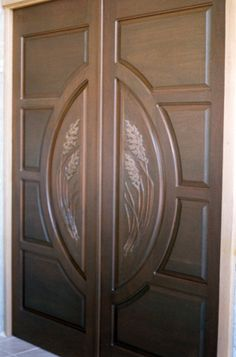 """Simon Sea Oats"""" by Fine Woodworks Custom Doors. This set of whitewashed mahogany doors were built to reflect their setting in the flowing marshes of St. Made of Honduran Mahogany. Visit our website for additional photos and pricing. Wooden Double Doors, Wooden Doors, Entry Doors, Front Doors, Modern Front Door, Wooden Door Design, Rustic Doors, Custom Wood, Woodworking"""